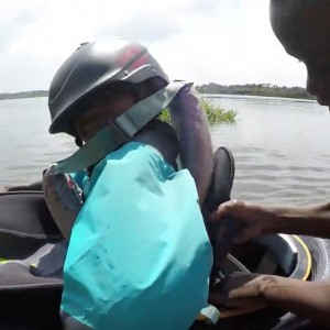 teaching african kid to kayak