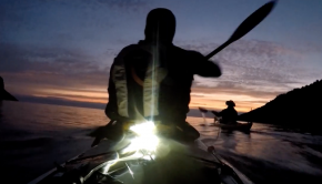 Sea kayaking from darkness to light