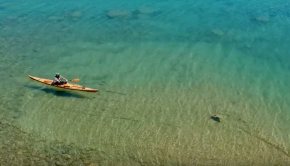 Crystal clear water + traditional wooden Kayak !