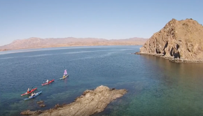 Mexico is home to 10% of the worlds wildlife and almost 40% of the world's species of whales and dolphins. The sea is clear and warm and you don't need a drysuit. Discover why one woman makes her annual migration down to Baja to kayak, surf and star gaze. Join her at surf camp, in Loreto and on a remote 14 day trip around the 2nd biggest island in the Sea of Cortez. There's a reason why Ginni Callahan says 'It's an addiction!' but she doesn't want a cure. With stunning drone footage, wildlife galore and good humor, this is the first film by Justine Curgenven in 3 years.