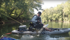 Catching a river monster on a kayak