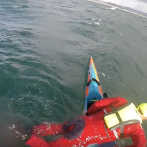 Remounting an elite surfski in extreme conditions