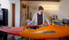 bren orton preparing his kayak for the season in the alps
