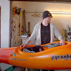bren orton preparing his kayak for the season in the alps